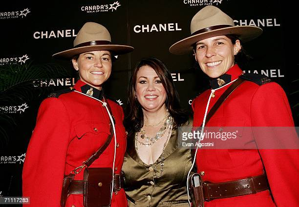 Singer Jann Arden poses with Royal Canadian Mounted Police Mia Poscente and April Dequanne at Canada's Walk Of Fame Gala sponsored by Chanel at the...