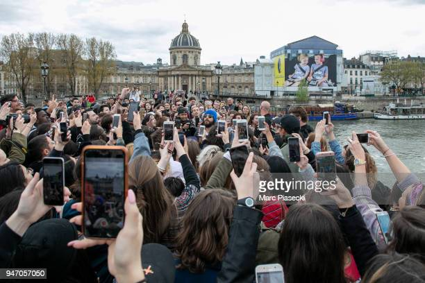 Singer Jared Leto of '30 Seconds to Mars' performs during an unexpected showcase on the 'Pont des Arts' on April 16 2018 in Paris France