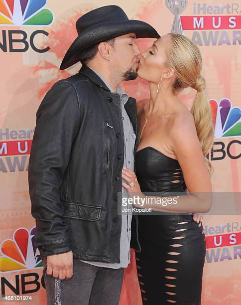 Singer Jason Aldean and wife Brittany Kerr arrive at the 2015 iHeartRadio Music Awards at The Shrine Auditorium on March 29 2015 in Los Angeles...