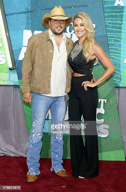 Singer Jason Aldean and wife Brittany Kerr attend the 2015 CMT Music awards at the Bridgestone Arena on June 10, 2015 in Nashville, Tennessee.
