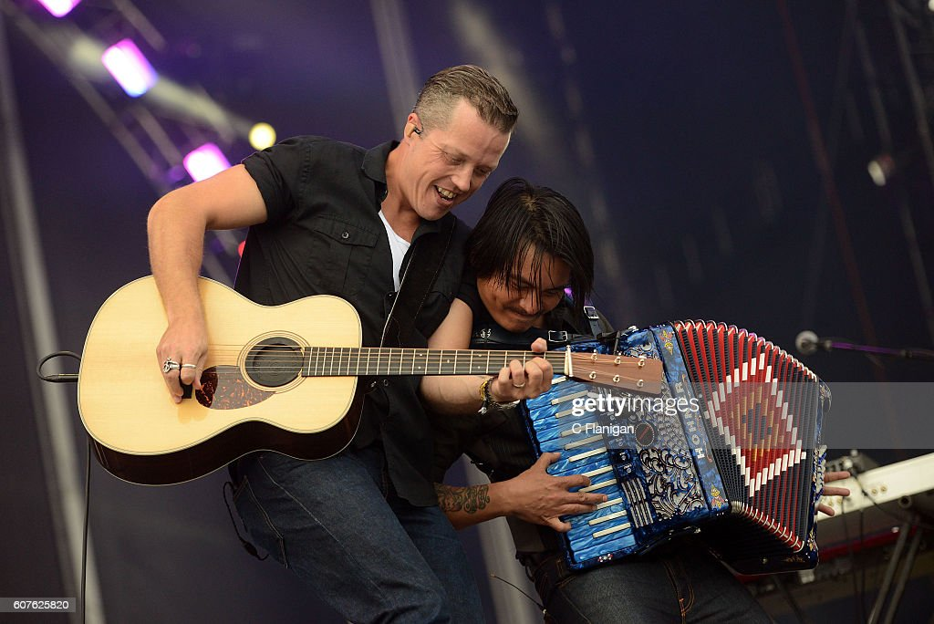 Singer Jason Isbell (L) performs on the Trestles stage during KAABOO Del Mar at the Del Mar Fairgrounds on September 18, 2016 in Del Mar, California.