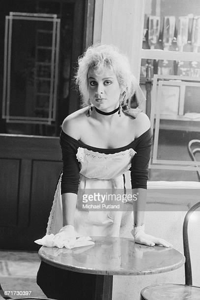 Singer Jay Aston of British pop group Bucks Fizz playing a waitress on the set of a video shoot for the single 'I Hear Talk' November 1984