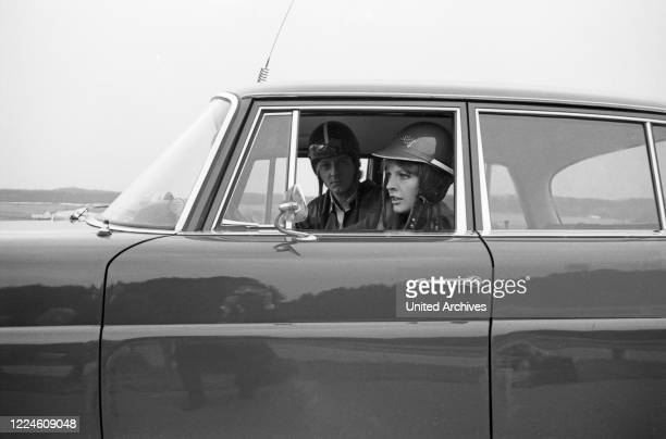 Singer Jay Walker on the road with actress Inge Marschall in a MAN truck, Germany, 1960s.