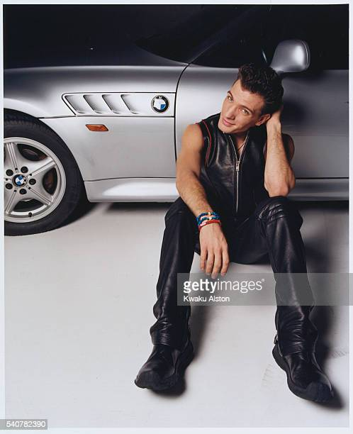 Singer JC Chasez of 'N Sync is photographed leaning against a BMW for YM Magazine in 2000 in Los Angeles California