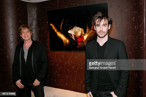 Singer JeanLouis Aubert and his son Arthur Aubert attend the Arthur Aubert Exhibition private view Held at Le Fouquet's Barriere Hotel on February 6...