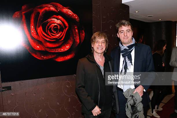 Singer JeanLouis Aubert and Philippe Perrot attend the Arthur Aubert Exhibition private view Held at Le Fouquet's Barriere Hotel on February 6 2014...