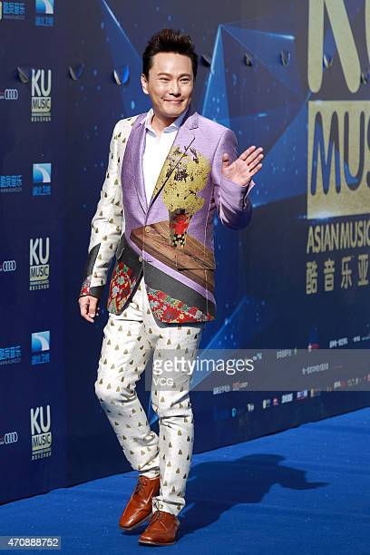 Singer Jeff Chang ShinChe arrives at the red carpet of Ku Music Asian Music Awards on April 23 2015 in Beijing China