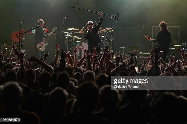 Singer Jeff Gutt guitarist Dean DeLeo bass player Robert DeLeo and drummer Eric Kretz of Stone Temple Pilots perform at Marquee Theatre on March 10...