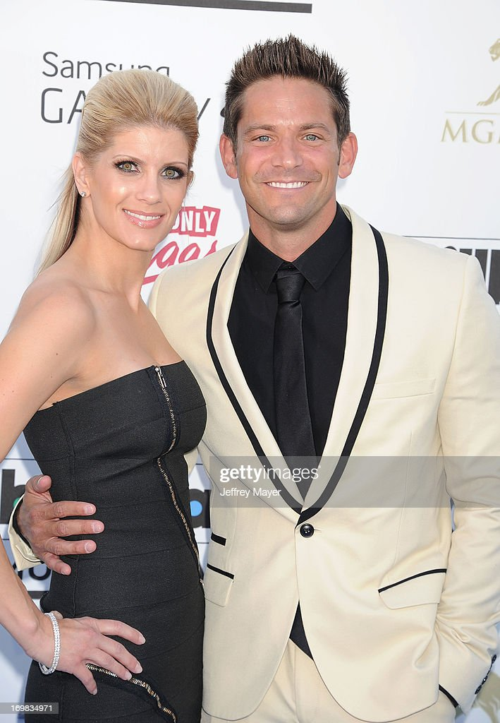 Singer Jeff Timmons of 98 Degrees (R) and his wife Amanda Timmons arrive at the 2013 Billboard Music Awards at the MGM Grand Garden Arena on May 19, 2013 in Las Vegas, Nevada.
