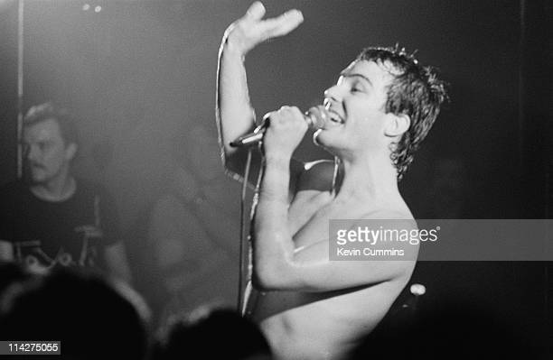 Singer Jello Biafra performing with American punk group the Dead Kennedys at Manchester Polytechnic October 1980