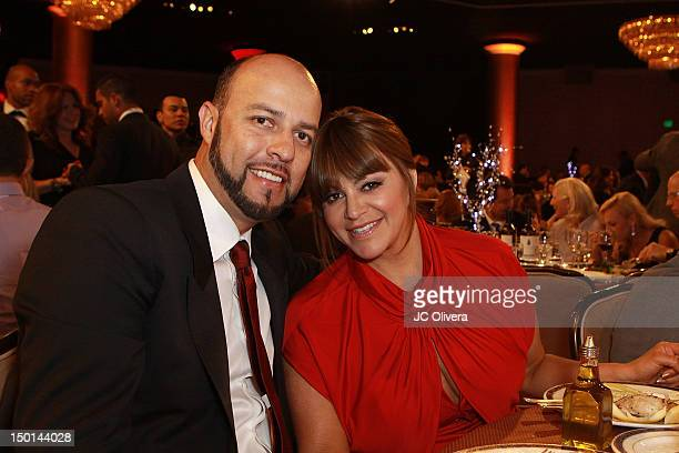 Singer Jenni Rivera and her husband Esteban Loaiza attend the 27th Annual Imagen Awards at The Beverly Hilton Hotel on August 10 2012 in Beverly...