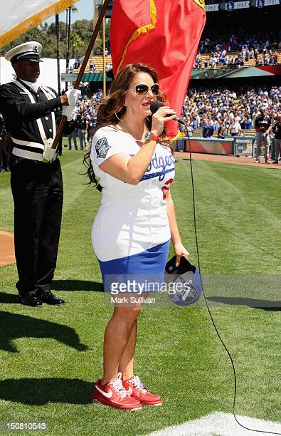Singer Jenni Rivera sings The National Anthem at Dodger Stadium on August 26 2012 in Los Angeles California
