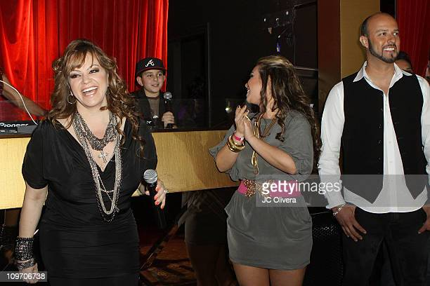 Singer Jenni Rivera TV personalities Johnny Rivera Janney Chiquis Marin and MLB Los Angeles Dodger's pitcher Esteban Loaiza smile during the premiere...