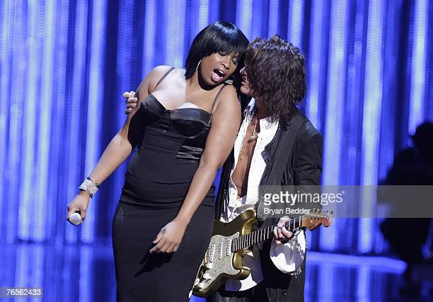 Singer Jennifer Hudson and guitarist Joe Perry perform onstage at the Conde Nast Media Group's Fourth Annual Fashion Rocks Concert at Radio City...