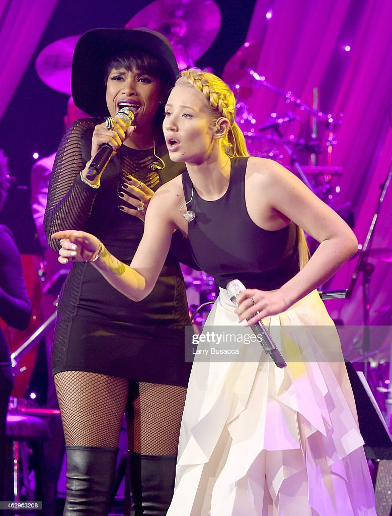 Singer Jennifer Hudson (L) and rapper Iggy Azalea perform onstage at the Pre-GRAMMY Gala and Salute To Industry Icons honoring Martin Bandier at The Beverly Hilton Hotel on February 7, 2015 in Beverly Hills, California.