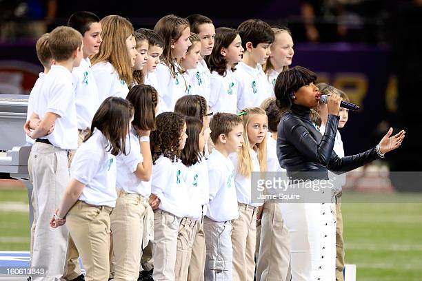 Singer Jennifer Hudson performs America The Beautiful with the Sandy Hook Elementary School Chorus prior to the start of Super Bowl XLVII between the...
