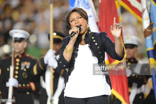 Singer Jennifer Hudson performs the national anthem before the pre-game show prior to the start of Super Bowl XLIII between the Arizona Cardinals and...