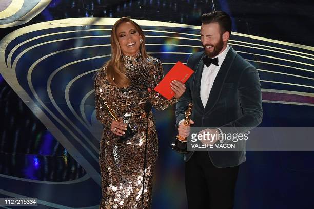 Singer Jennifer Lopez and actor Chris Evans present an award during the 91st Annual Academy Awards at the Dolby Theatre in Hollywood California on...