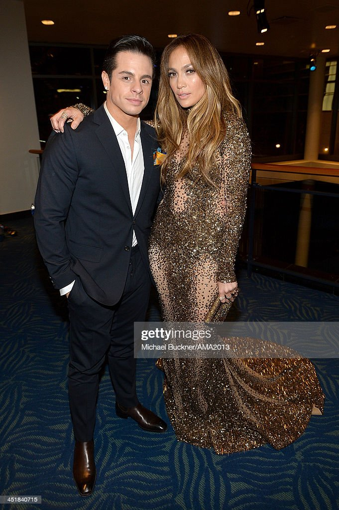 Singer Jennifer Lopez (R) and Casper Smart attend the 2013 American Music Awards at Nokia Theatre L.A. Live on November 24, 2013 in Los Angeles, California.