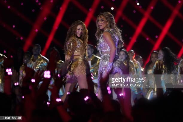 US singer Jennifer Lopez and Colombian singer Shakira perform during the halftime show of Super Bowl LIV between the Kansas City Chiefs and the San...