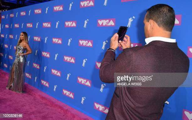 Singer Jennifer Lopez and former US baseball player Alex Rodriguez attend the 2018 MTV Video Music Awards at Radio City Music Hall on August 20, 2018...