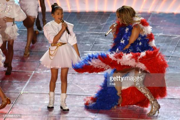Singer Jennifer Lopez and her daughter Emme Maribel Muñiz perform while a Puerto Rican flag is displayed on stage during the Pepsi Super Bowl LIV...