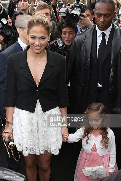 Singer Jennifer Lopez and her daughter Emme Maribel Muniz Anthony arrive to attend the Chanel Spring / Summer 2013 show as part of Paris Fashion Week...
