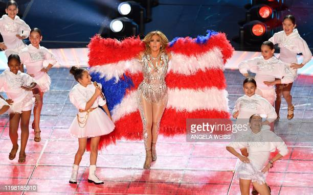 TOPSHOT US singer Jennifer Lopez and her daughter Emme Muniz perform during the halftime show of Super Bowl LIV between the Kansas City Chiefs and...