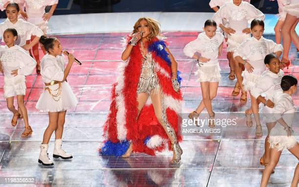 US singer Jennifer Lopez and her daughter Emme Muniz perform during the halftime show of Super Bowl LIV between the Kansas City Chiefs and the San...