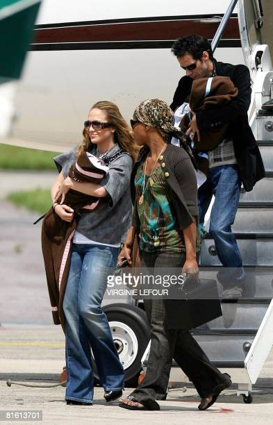 US singer Jennifer Lopez and her husband Puerto Rican singer Marc Anthony arrive with their children Marc and Emme in Zaventem on June 18 2008...