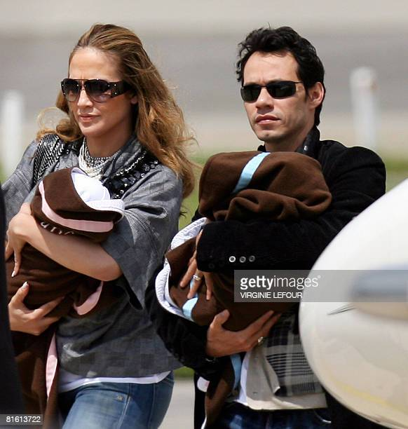 US singer Jennifer Lopez and her husband Puerto Rican singer Marc Anthony arrive with their children Max and Emme in Zaventem on June 18 2008 Anthony...