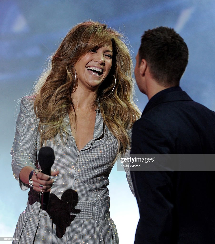 Singer Jennifer Lopez (L) and host Ryan Seacrest appear onstage at a press conference to officially announce the season 10 'American Idol' judges panel at The Forum on September 22, 2010 in Inglewood, California.