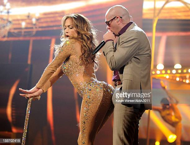 Singer Jennifer Lopez and rapper Pitbull perform onstage at the 2011 American Music Awards held at Nokia Theatre LA LIVE on November 20 2011 in Los...