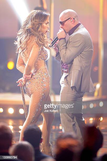 Singer Jennifer Lopez and rapper Pitbull perform onstage at the 2011 American Music Awards at Nokia Theatre LA Live on November 20 2011 in Los...