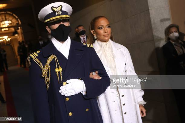 Singer Jennifer Lopez is escorted to the inauguration of US President-elect Joe Biden on the West Front of the US Capitol on January 20, 2021 in...
