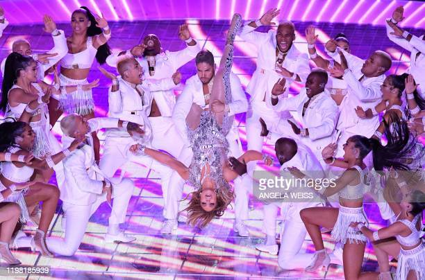 TOPSHOT US singer Jennifer Lopez performs during the halftime show of Super Bowl LIV between the Kansas City Chiefs and the San Francisco 49ers at...