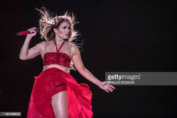 Singer Jennifer Lopez performs onstage during her concert on the beach of North Coast city of New Alamein, north of the Egyptian Capital Cairo on...