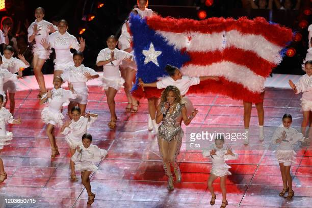 Singer Jennifer Lopez performs while a Puerto Rican flag is displayed on stage during the Pepsi Super Bowl LIV Halftime Show at Hard Rock Stadium on...