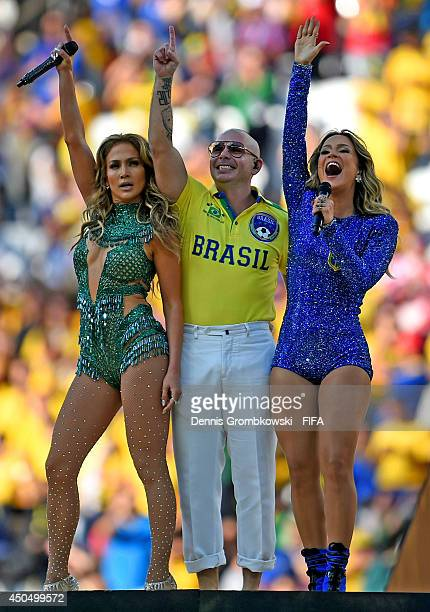Singer Jennifer Lopez rapper Pitbull and singer Claudia Leitte perform during the 2014 FIFA World Cup Brazil Opening Ceremony at Arena de Sao Paulo...