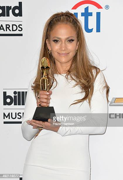 Singer Jennifer Lopez recipient of the Icon Award poses in the press room during the 2014 Billboard Music Awards at the MGM Grand Garden Arena on May...