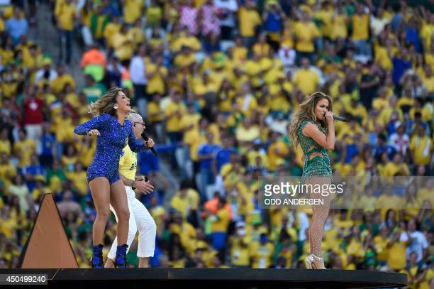 US singer Jennifer Lopez US rapper Pitbull and Brazilian pop singer perform during the opening ceremony of the 2014 FIFA World Cup at the Corinthians...