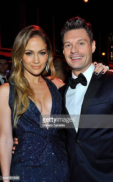 Singer Jennifer Lopez, wearing Gucci, and TV personality Ryan Seacrest attend the 2014 LACMA Art + Film Gala honoring Barbara Kruger and Quentin...