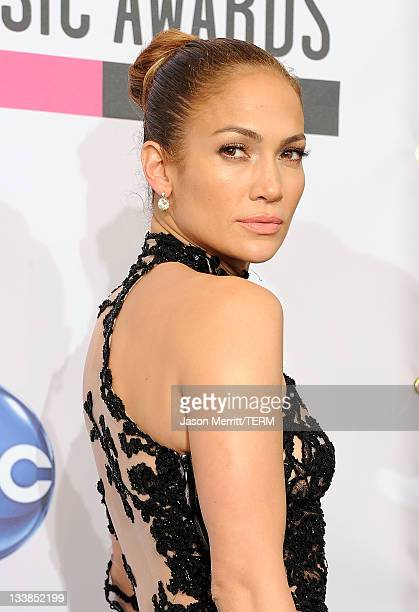 Singer Jennifer Lopez winner of Favorite Latin Artist Award poses in the press room at the 2011 American Music Awards held at Nokia Theatre LA LIVE...