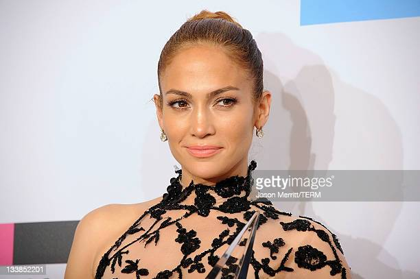 Singer Jennifer Lopez, winner of Favorite Latin Artist Award, poses in the press room at the 2011 American Music Awards held at Nokia Theatre L.A....