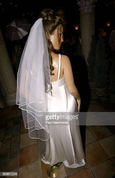 Singer Jennifer Lopez's wax figure stands dressed in wedding gown and veil at Madame Tussauds June 11 2004 in New York City