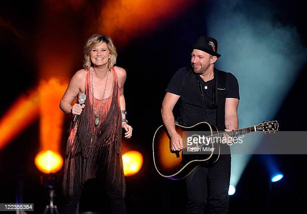 """Singer Jennifer Nettles and guitarist/singer Kristian Bush of Sugarland perform at the Mandalay Bay Events Center in support of the album, """"The..."""