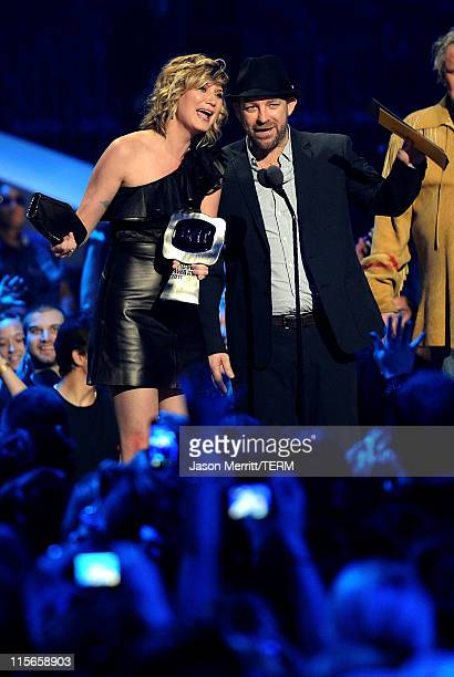 Singer Jennifer Nettles and musician Kristian Bush of Sugarland accept the Duo Video of the Year award on stage at the 2011 CMT Music Awards at the...