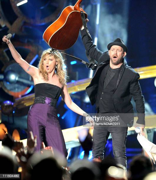Singer Jennifer Nettles and musician Kristian Bush of the band Sugarland perform at the 46th Annual Academy of Country Music Awards ACM Fan Jam with...