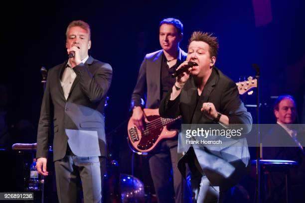 Singer Jens Sembdner and Sebastian Krumbiegel of the German band Die Prinzen perform live on stage during a concert at the Admiralspalast on March 3...