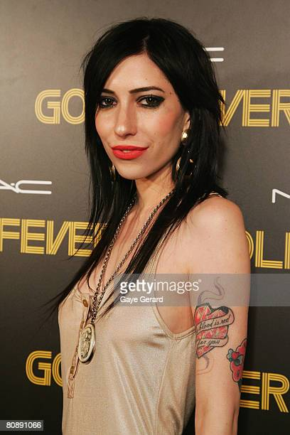 """Singer Jess Origliasso of """"The Veronicas"""" arrives on the red carpet at the MAC Cosmetics Gold Fever Party on the first day of the Rosemount..."""